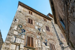 The façade of Palazzo Pretorio, ancient seat of political and military power, with coats of arms and inscriptions, in Campiglia Marittima, province of Livorno, Tuscany, Italy