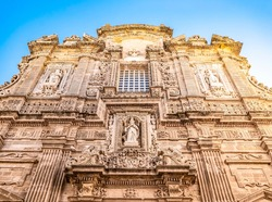 The façade of the Baroque cathedral of Sant'Agata built in the 17th century, Gallipoli, Salento, Puglia region, Italy. Facade decorated in carparo, a local limestone, with statues of saints.
