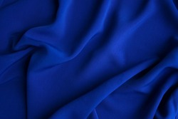 The fabric is dark blue. Material background.