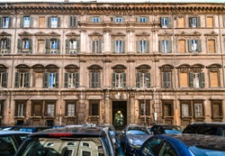 The facade and inner courtyard of a typical classical Italian office building in the historic center of Rome Italy