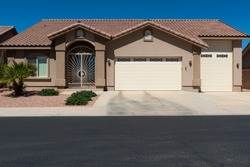 The facade of a residential house in a suburb area in the State of Nevada, USA.