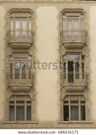 The facade of an old European building with window and balcony in the style of art nouveau. Budapest, Hungary - Shutterstock ID 688636171