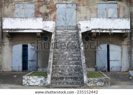 The Facade of An Old Japanese Military Facility, with Heavy Iron Blast Doors And A Stair Leading to The Second Floor. Built in 1917. Located in Kaohsiung, Taiwan.