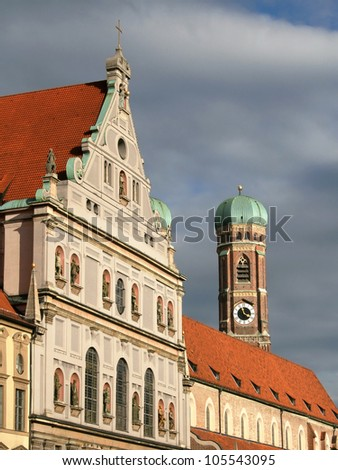 The facade of Michaelskirche with the tower of Frauenkirche in the background, Munich, Germany.