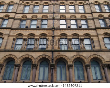 the facade of the former milligan and forbes warehouse in bradford west yorkshire a large palazzo style building built by andrew and delauney in 1853