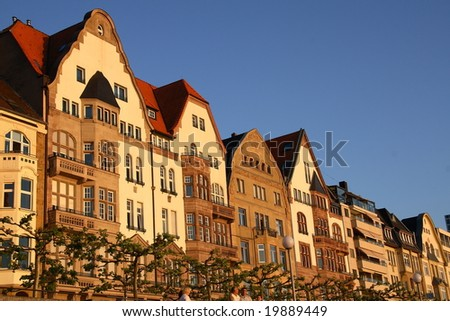 The facades of the quay of Dusseldorf at the sunset