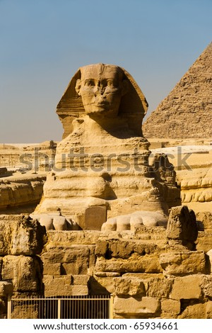 The face and paws of the Great Sphinx is seen directly head-on at the Giza Pyramids in Cairo, Egypt. Vertical copy space