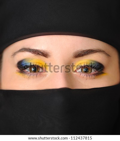 The face of beautiful girl in a black yashmak - stock photo