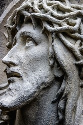 The face of Jesus Christ close up. Wreath of thorns and suffering