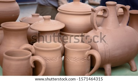 The fair sells handmade ceramic pots for cooking.