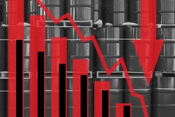 The fall in the value of crude oil. Concept - The demand for crude oil is declining. Red graph on the background of barrels. The arrow indicates a decrease in prices. Decline in crude oil production