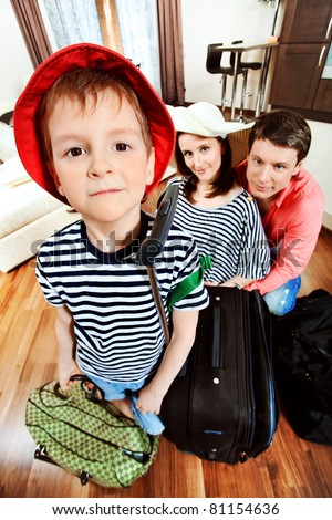 The family at home with a big suitcases is going to vacation.