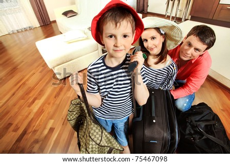 The family at home with a bigsuitcases