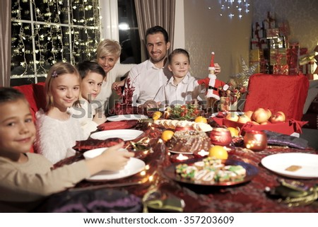 The family at the table at Christmas. #357203609