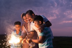 The family enjoying the sparkle fireworks as part of the celebration of a festival
