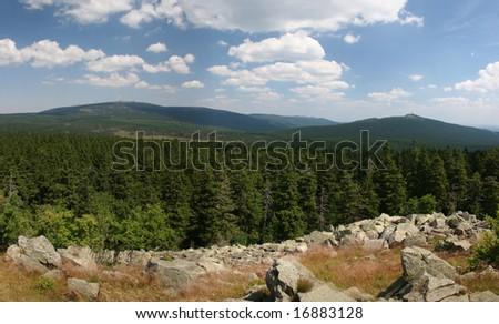 The famous and mystic Mt. Brocken, highest mountain of northern Germany, and Mt. Wurmberg in the national park Harz, seen from the Achtermann rocks.