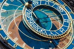 The Famous Astronomical Clock in Prague. Close-up on the dial with golden details.