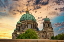 The famous Berliner Dom (Berlin Cathedral) in Berlin at sunset, view from the Friedrichsbrücke