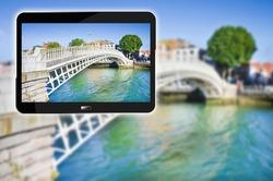The famous bridge in Dublin called Half penny bridge (Ireland - Europe) - 3D render concept image with digital tablet.