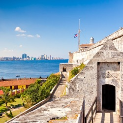 The famous castle and lighthouse of El Morro in Havana with a view of the city