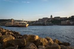 The famous Chain bridge with the castle in the background at sunset, Budapest, Hungary