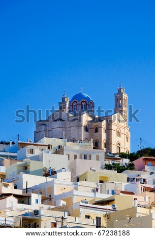 The famous church on the island of Syros, surrounded by houses on the hill. Typical of the Greek islands.
