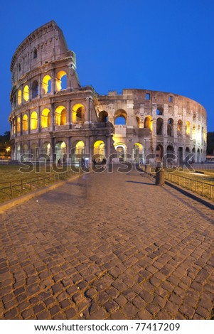 The famous Colosseum (or Coliseum) in Rome, Italy at dusk