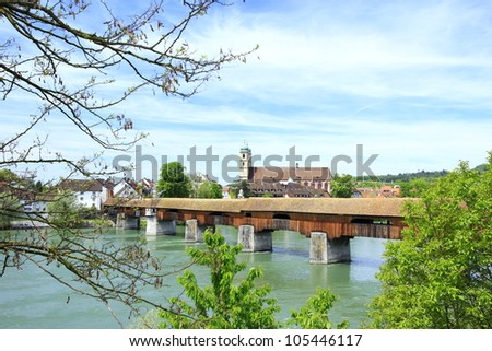 the famous covered wooden bridge over the Rhine from the German shore of Bad S�¤ckingen to the Swiss banks