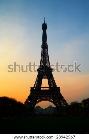 The famous Eiffel tower in Paris with a beautiful sunset