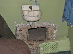 The famous escape tunnel made by Frank Morris at Alcatraz Island penitentiary in San Francisco California
