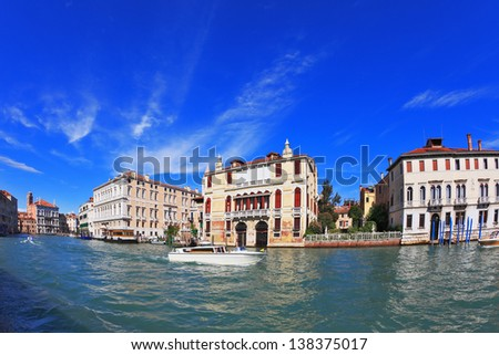 The famous Grand Canal in Venice. In the foreground is a graceful white yacht. Photo taken by lens Fisheye