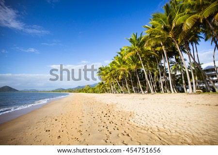 The famous idyllic beachfront of Palm Cove on a winter's day in Queensland, Australia #454751656