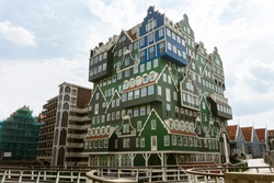 The famous Inntel hotel in the center of Zaandam with on the outside the different facades that were known in historical Zaandam, Netherlands.