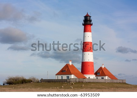 The famous lighthouse Westerhever or Westerheversand in Schleswig-Holstein, Germany. The lighthouse is located at the coast of the North Sea in the Schleswig-Holstein Wadden Sea National Park.