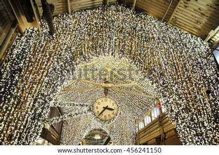 The famous lights with the beautiful clock inside Chelsea Market in New York #456241150