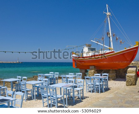The famous red boat and a tavern on the island of Mykonos
