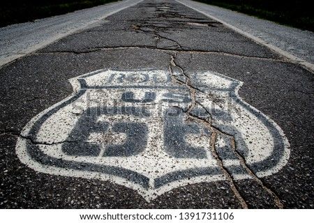 The famous route 66 highway shield painted on ta histroic stretch of single lane highway dating from the 1920's