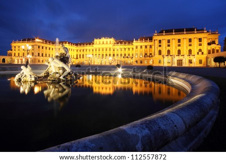 The famous Schonbrunn Palace in Vienna, Austria, with its beautiful water fountains in front, by twilight.