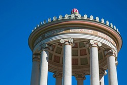 The famous temple Monopteros and Munich town's landmark with its green dome and red top and columns of limestone after the restoration in 2016 close up