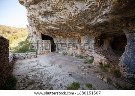 The famous Tito's cave (Titova spilja) consists of two small caves with a partially walled entrance where Josip Broz Tito and the partisan leadership secretly resided during WW2 Stock fotó ©