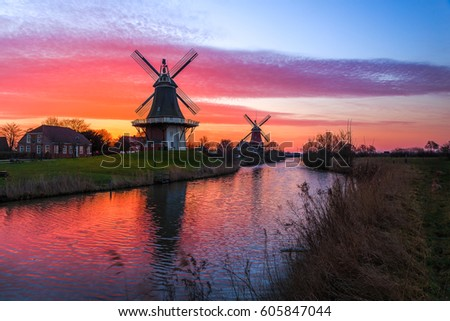 The famous twin mills of Greetsiel, East Frisia at sunrise