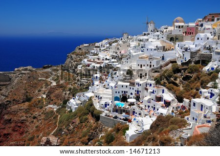 the famous village of Oia hanging from the cliffs in Santorini island - Greece