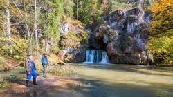 the famous waterfall atysh flowing from a karst funnel in the Ural mountains of Bashkortostan on an autumn sunny day