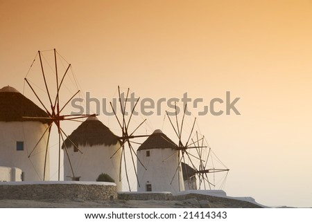 The famous windmills of Mykonos island (Greece) at sunset - stock photo