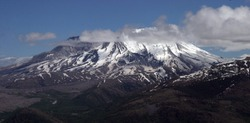 The famously top-blown volcano Mount St. Helens remains a stark sight.