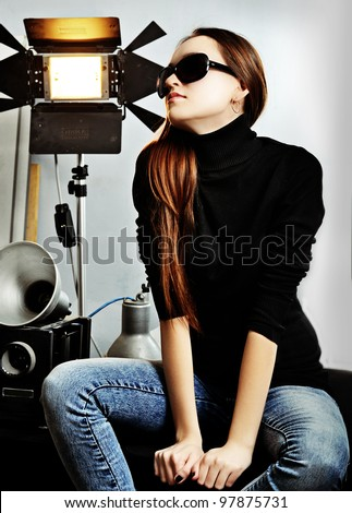 The fashionable girl and photographic equipment - stock photo