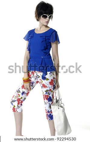 The fashionable young female with white a bag on white background