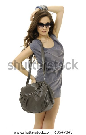 Lifestyle - Pagina 5 Stock-photo-the-fashionable-young-woman-in-sunglasses-with-handbag-63547843