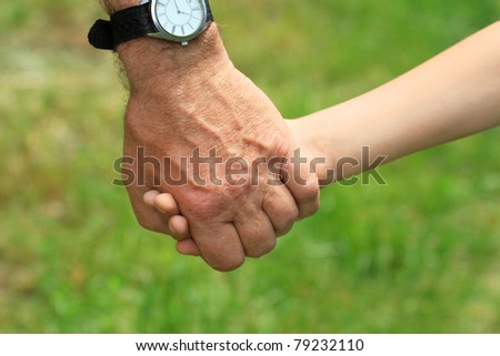 the father gives the child's hand