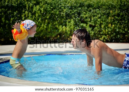 The father with the child in pool